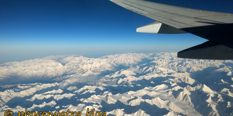 Snow capped mountains from plane