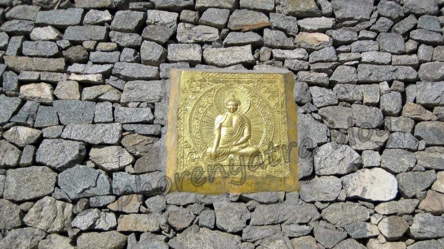 buddha carving in the wall at shanti stupa