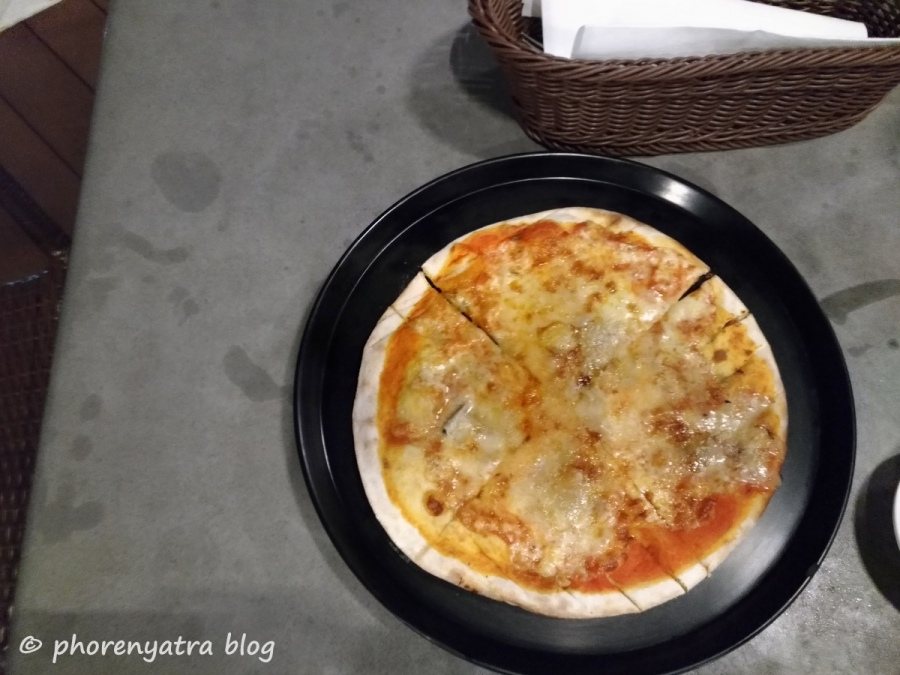 quattro fromaggio pizza at modesto's